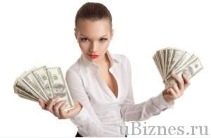 Красивая девушка, на белом фоне с пачками долларов в руках