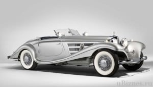 Серебристый Mercedes-Benz 540 K Spezial Roadster на белом фоне